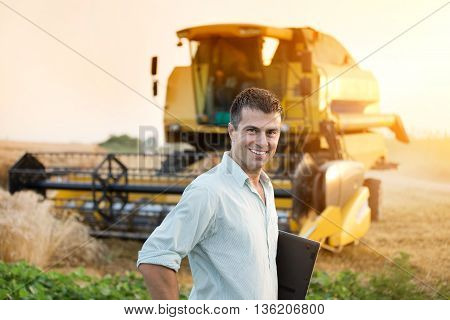 Agricultural Engineer On Wheat Harvest
