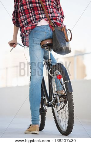 Hipster riding a bike in the city
