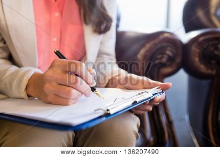Psychologist writing notes on office