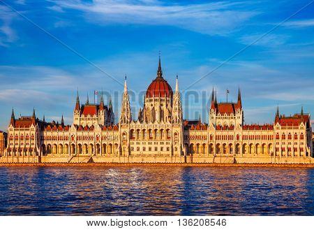 Sunset evening with building of hungarian parliament at danube river in budapest city hungary