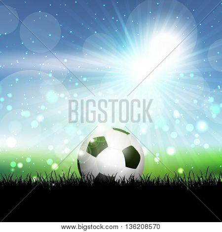 Soccer ball nestled in grass against a blue sunny sky