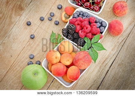 Healthy fruits in bowl on table - organic fruits