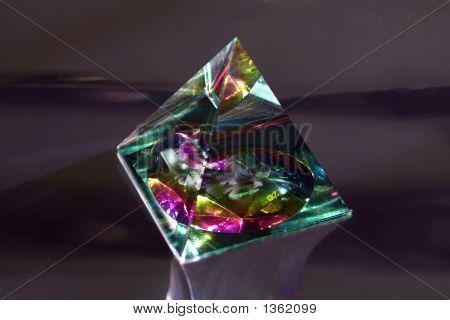 Triangular Prisym On Dark Chrome Background