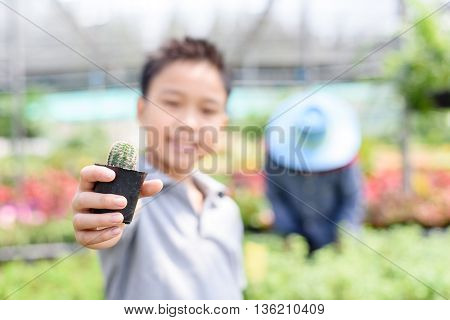 Boy Carry Cactus