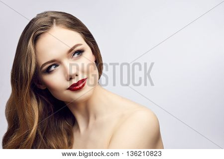 Fashion portrait of gorgeous young blond woman with red lips. Shallow depth of field. Copy space on right