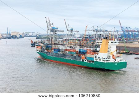 Hamburg, Germany - June 25, 2016: Industrial quay of Hamburg. Giant machines and ships viewed from Dockland