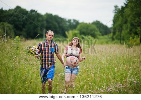 Happy Young Couple Expecting Baby, Pregnant Woman With Painted Belly