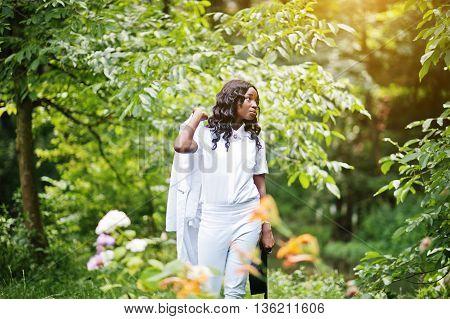 Stylish Black African American Girl Holding Jacket On Her Shoulder At Green Park