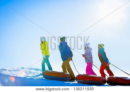 Young people with a tube outdoors