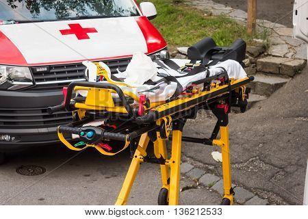 Empty Yellow Gurney Near Ambulance, Ready For Emergency