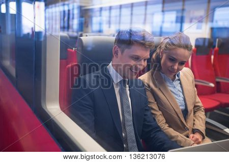 Young business people in a train