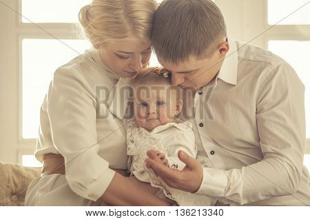 Family, Mom, Dad And Daughter Embrace Together Beautiful And Happy