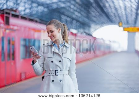 Smiling businesswoman with phone