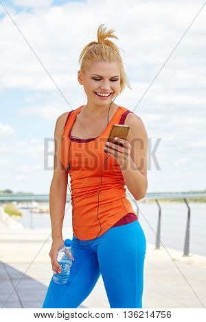Fitness - portrait of woman listen music mp3 relax in gym