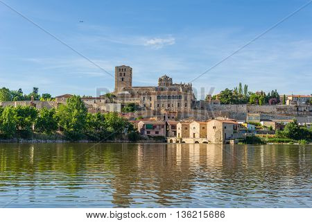 San Salvador Cathedral of Zamora and acenas (water mills) view from Duero river. Castilla y Leon Spain.