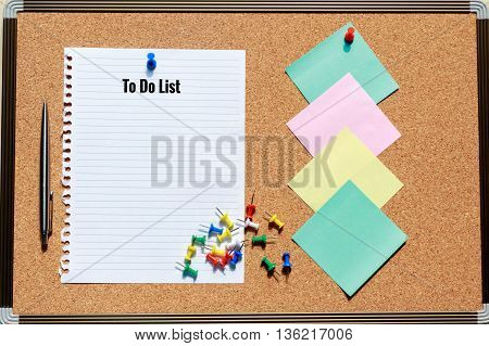 Sheet of paper with cork board pen colorful push pin and sticky note - To do list wording concept