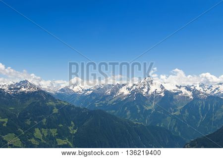 Mountain ranges of the Zillertal with snow and blue sky during summer in Tyrol, Austria, Europe