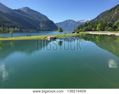 View of the Achensee, northern part of Achen Lake with clear blue sky and fresh water during summer in Tyrol, Austria, Europe