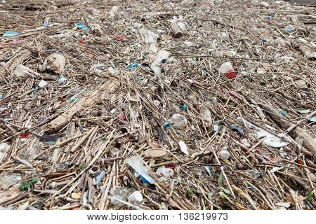Plastic and resin based trash or being washed up at shore. non- biodegradable waste .Ecology concept.