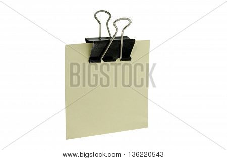 clerical clothespin with piece of paper on white background