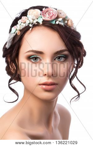 Portrait of young beautiful bride. Wedding coiffure and make-up. Studio shot