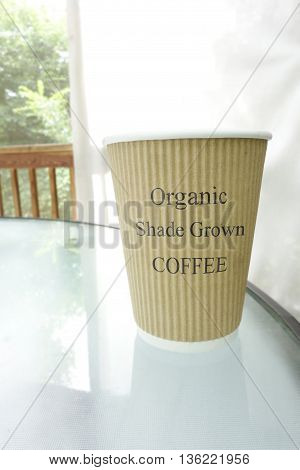 Coffee cup with Organic Shade Grown text poster