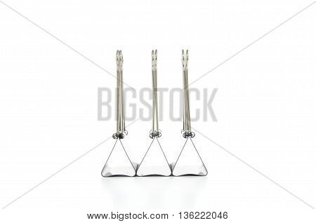 three clerical clothespins on a white background