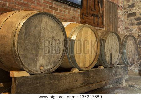 Old and used wine barrels in a cellar