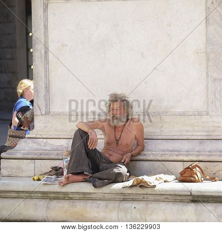 Florence, Italy - June, 25, 2016: bum in the center of Florence, Italy