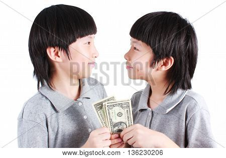 Portrait of two boys, twins holding money isolated on white.