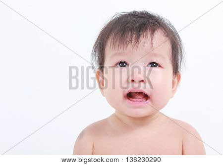 Cute asian baby isolated on white, about to cry.
