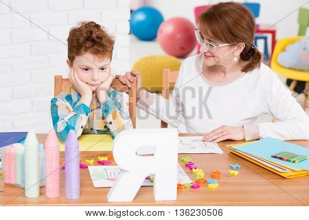 Friendly Child Therapist Trying To Reach The Boy's Mind
