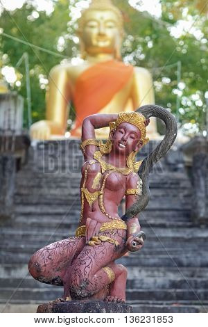 Phra Mae Thorani the Buddhist goddess of earth statue in Koh Phayam Thailand