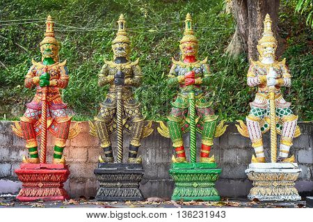 Thailand traditional Buddhist Yaksa warrior guards statues