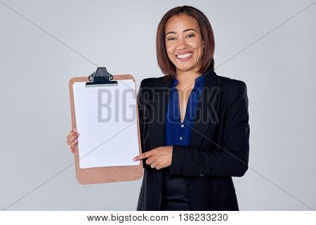 Happy indian hispanic latino mixed race corporate business woman holding clipboard with copy space