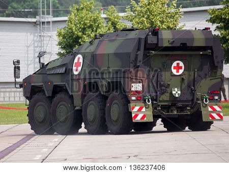 BURG / GERMANY - JUNE 25 2016: german armoured ambulance vehicle Boxer drives on open day in barrack burg / germany at june 25 2016.