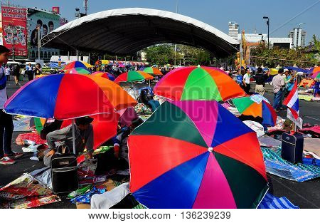 Bangkok Thailand- January 16 2014: Colourful umbrellas shade protestors from the hot sun at the Victory Monument during Shut Down Bangkok demonstration *