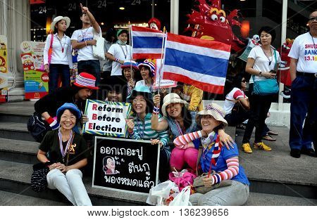 Bangkok Thailand - January 13 2014: Thais holding political signs during the anti-government Operation Shut Down Bangkok demonstration