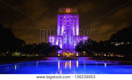 Houston Texas City Hall building lit up at night with reflecting pool