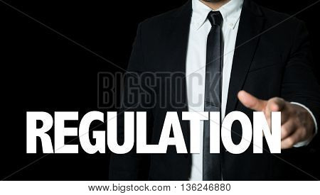 Business man pointing the text: Regulation