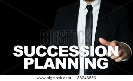 Business man pointing the text: Succession Planning