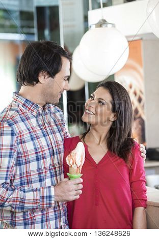Couple With Vanilla Ice Cream Looking At Each Other