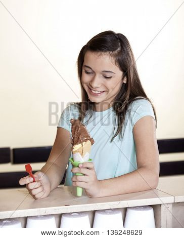 Girl Looking At Chocolate Ice Cream  Counter