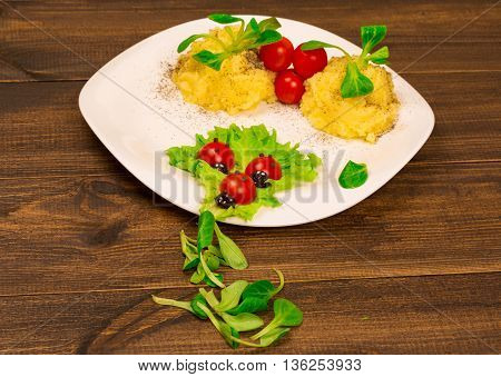 Salad With Tomatoes Decorated In The Form Of Ladybugs With Mashed Potatoes