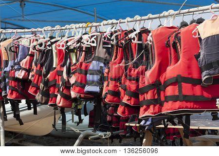 Orange life jacket. Old rescue vintage lifevest object for safe sailing