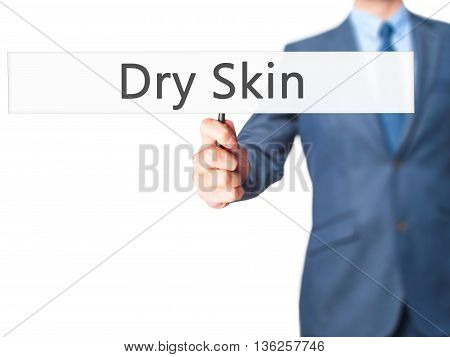 Dry Skin - Businessman Hand Holding Sign
