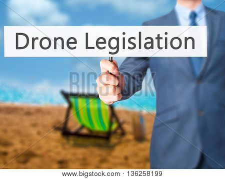 Drone Legislation - Businessman Hand Holding Sign