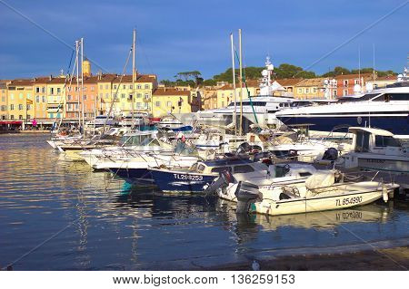 ST TROPEZ FRANCE JUNE 04 2016: Modern boats in the harbour in front of traditional Provence houses