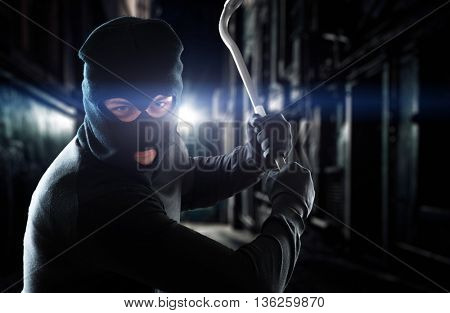 Thief holding a crowbar