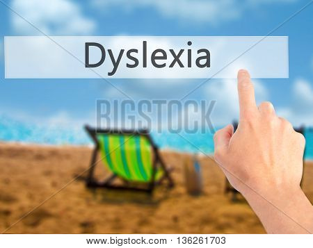 Dyslexia - Hand Pressing A Button On Blurred Background Concept On Visual Screen.